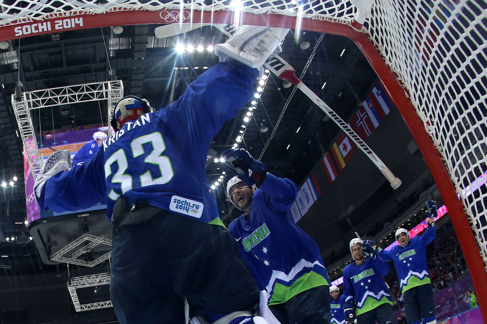 . Slovenia\'s players celebrate after winning the Men\'s Ice Hockey Play-offs Slovenia vs Austria at the Bolshoy Ice Dome during the Sochi Winter Olympics on February 18, 2014. Slovenia won 4-0.  (BRUCE BENNETT/AFP/Getty Images)