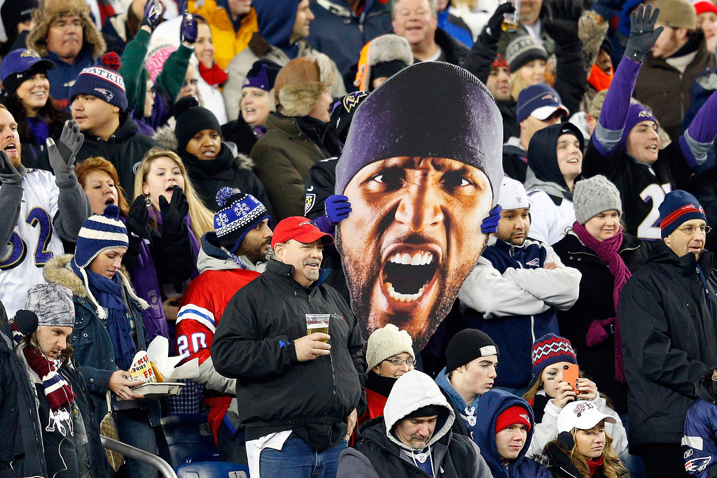 . A fan holds up a giant photo of the face of Ray Lewis #52 of the Baltimore Ravens during the 2013 AFC Championship game at Gillette Stadium on January 20, 2013 in Foxboro, Massachusetts.  (Photo by Jim Rogash/Getty Images)