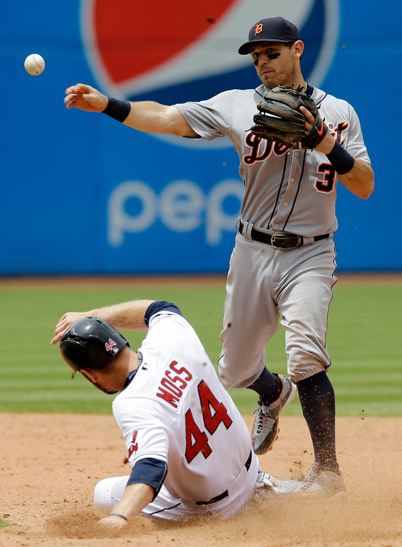 . Detroit Tigers\' Ian Kinsler (3) forces out Cleveland Indians� Brandon Moss (44) at second base while trying to turn a double play in the sixth inning of a baseball game, Wednesday, June 24, 2015, in Cleveland. Yan Gomes was safe at first base on the play. (AP Photo/Tony Dejak)