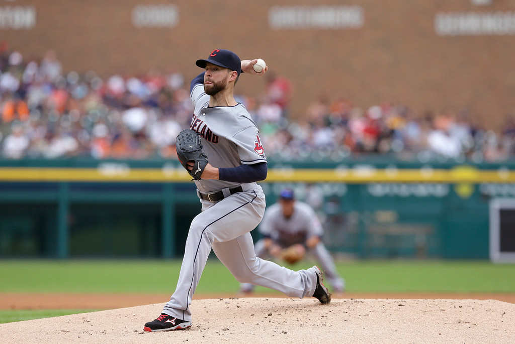 . Cleveland Indians starting pitcher Corey Kluber throws during the first inning in the first baseball game of a doubleheader against the Detroit Tigers, Saturday, July 19, 2014 in Detroit. (AP Photo/Carlos Osorio)