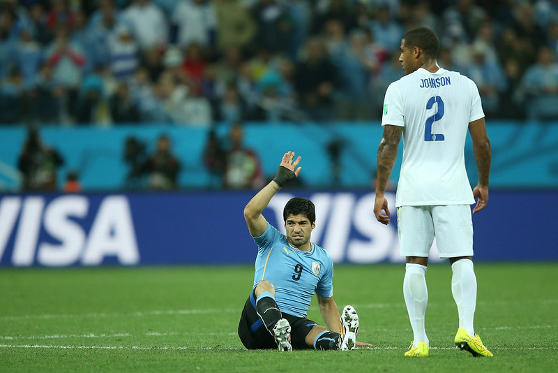 . Luis Suarez of Uruguay reacts after a challenge as Glen Johnson of England looks on during the 2014 FIFA World Cup Brazil Group D match between Uruguay and England at Arena de Sao Paulo on June 19, 2014 in Sao Paulo, Brazil.  (Photo by Richard Heathcote/Getty Images)