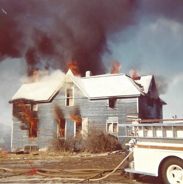 Kessler training recruits at fire building.jpg