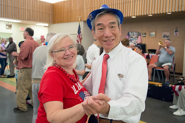 07/03/19 Wesley Bunnell | Staff The New Britain Senior Center was the scene for a 4th of July Red White & Boom Party presented by Autumn Lake on Wednesday July 3, 2019. The event featured food, raffle items and a live band. Mary Laciz and Henry Ye dance together.
