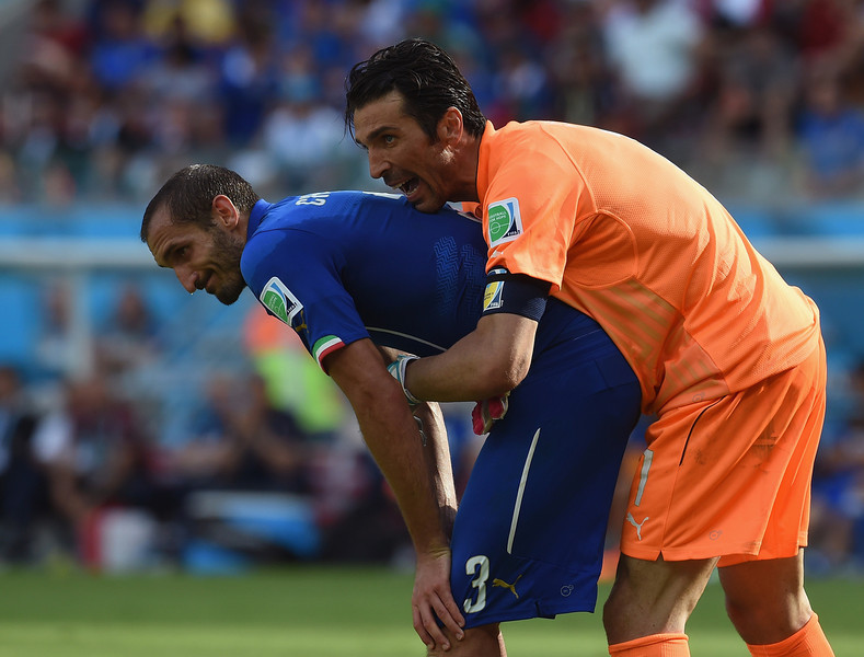 . Gianluigi Buffon hugs Giorgio Chiellini of Italy during the 2014 FIFA World Cup Brazil Group D match between Italy and Costa Rica at Arena Pernambuco on June 20, 2014 in Recife, Brazil.  (Photo by Claudio Villa/Getty Images)