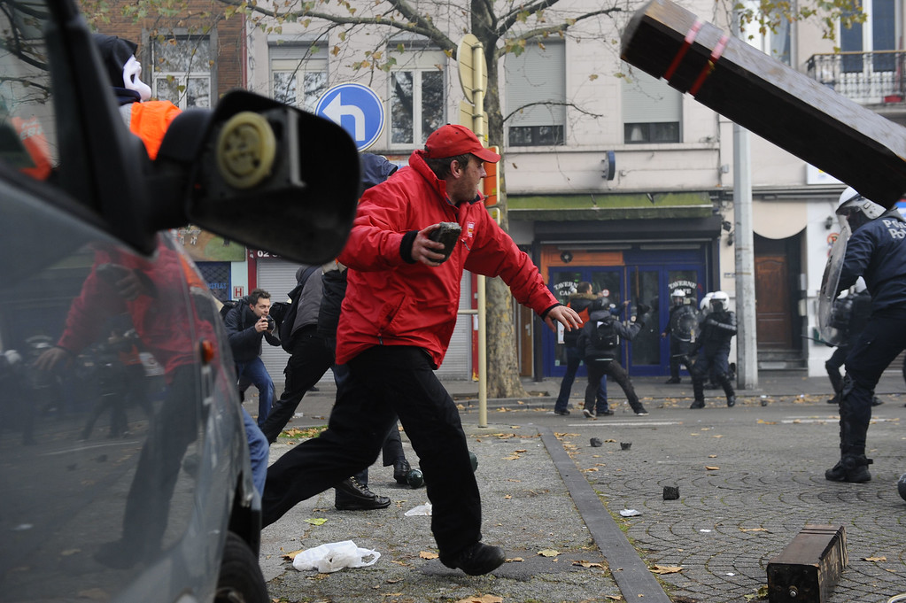 . Protestors fight with anti riot police officers on November 6, 2014 in Brussels, during a huge march, the first mass protest against the new centre-right government\'s austerity policies.  AFP PHOTO / JOHN THYS/AFP/Getty Images