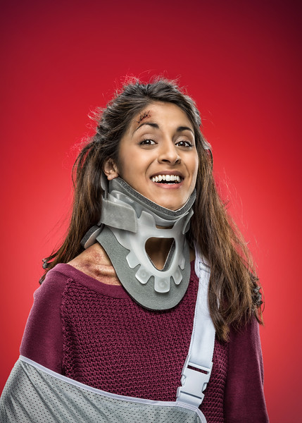 Portrait of a woman excited about her neck and arm injuries