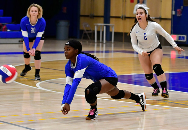 10/25/2018 Mike Orazzi | Staff Plainville's Shai-yonna Durham (9) during a loss to Kennedy during girls volleyball in Plainville Thursday night.