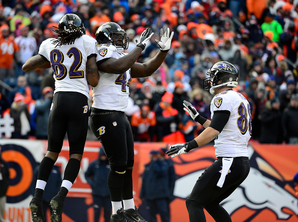 Description of . Baltimore Ravens wide receiver Torrey Smith (82), Baltimore Ravens fullback Vonta Leach (44) and Baltimore Ravens tight end Dennis Pitta (88) celebrate a 59-yard touchdown reception by Smith in the first quarter. The Denver Broncos vs Baltimore Ravens AFC Divisional playoff game at Sports Authority Field Saturday January 12, 2013. (Photo by AAron  Ontiveroz,/The Denver Post)