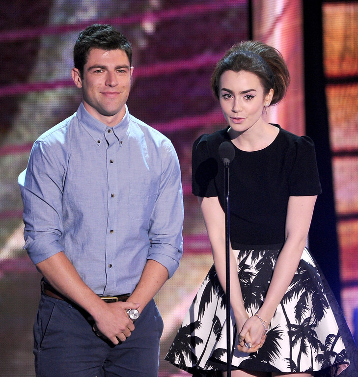 . Actors Max Greenfield and Lily Collins speak onstage during the Teen Choice Awards 2013 at Gibson Amphitheatre on August 11, 2013 in Universal City, California.  (Photo by Kevin Winter/Getty Images)