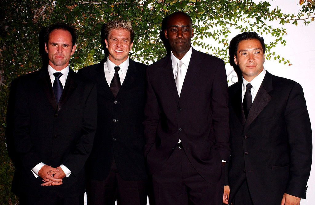 . Actors Walton Goggins, Kenneth Johnson, Michael Jace and Benito Martinez arrive at the Fox TV Emmy After Party at Mortons on September 21, 2003 in West Hollywood, California.  (Photo by Amanda Edwards/Getty Images)