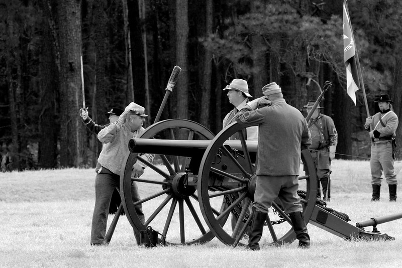Confederate artillery reenactors prepare to fire a Parrott Rifle. The Skirmish at Gamble's Hotel happened on March 5, 1885 when 500 federal soldiers, under the command of Reuben Williams of the 12th Indiana Infantry, marched into Florence to destroy the railroad depot but were met by Confederate soldiers backed up with 400 militia. The reenactment, held by the 23rd South Carolina Infantry, was held at the Rankin Plantation in Florence, South Carolina on Saturday, March 5, 2011. Photo Copyright 2011 Jason Barnette