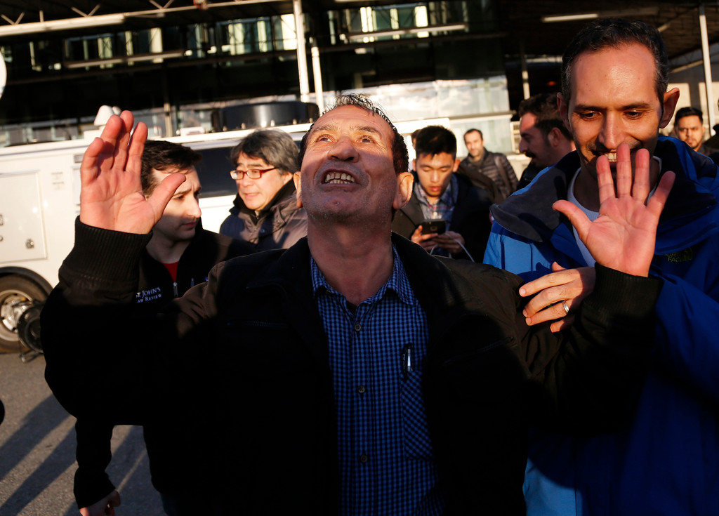 . Zabihollah Zarepisheh, of Iran, reacts as he leaves John F. Kennedy International airport in New York, Sunday, Jan. 29, 2017. Attorneys advocating on his behalf said he had been held for more than 30 hours at the airport. President Donald Trump\'s immigration order sowed more chaos and outrage across the country Sunday, with travelers detained at airports, panicked families searching for relatives and protesters registering opposition to the sweeping measure that was blocked by several federal courts. (AP Photo/Seth Wenig)