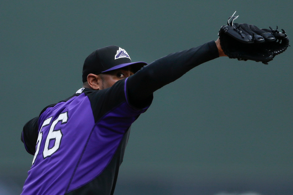 . Colorado Rockies starting pitcher Franklin Morales throws against the Arizona Diamondbacks during the first inning in a spring training baseball game Friday, Feb. 28, 2014, in Scottsdale, Ariz. (AP Photo/Gregory Bull)