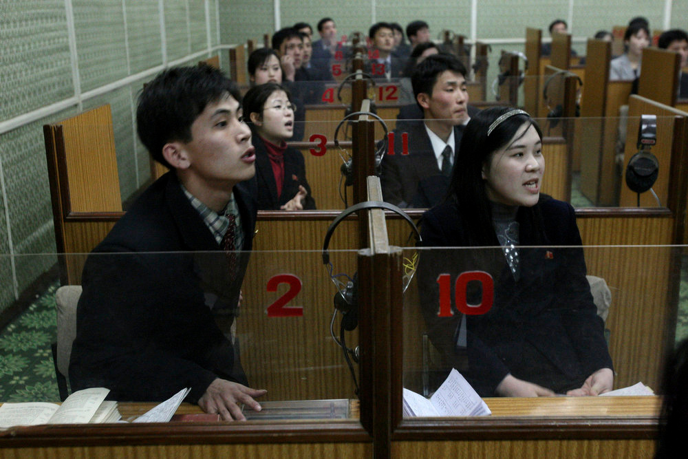 Description of . North Korean English language students answer a teacher's questions at a classroom in Pyongyang, North Korea on Tuesday, Feb. 26, 2008.  (AP Photo/David Guttenfelder)