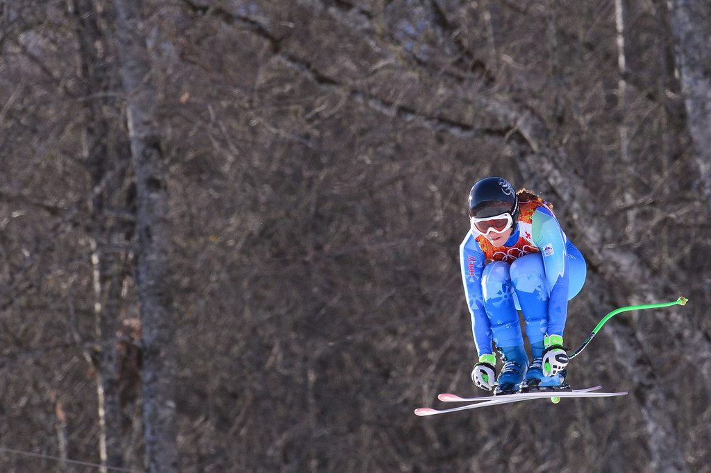 . Slovenia\'s Tina Maze skis during the Women\'s Alpine Skiing Downhill at the Rosa Khutor Alpine Center during the Sochi Winter Olympics on February 12, 2014.   AFP PHOTO / DIMITAR DILKOFF/AFP/Getty Images