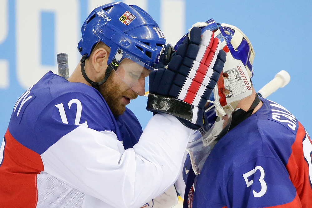 . Czech Republic forward Jiri Novotny comforts goaltender Alexander Salak after their 5-2 loss to the Unites States in the men\'s quarterfinal hockey game in Shayba Arena at the 2014 Winter Olympics, Wednesday, Feb. 19, 2014, in Sochi, Russia. (AP Photo/David J. Phillip )