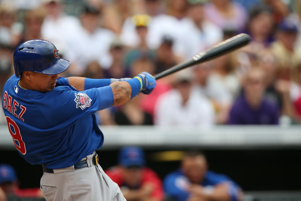 . Chicago Cubs\' Javier Baez extends his swing after connecting for a solo home run to lead off the sixth inning of the Cubs\' 6-2 victory over the Colorado Rockies in a baseball game in Denver on Thursday, Aug. 7, 2014. (AP Photo/David Zalubowski)
