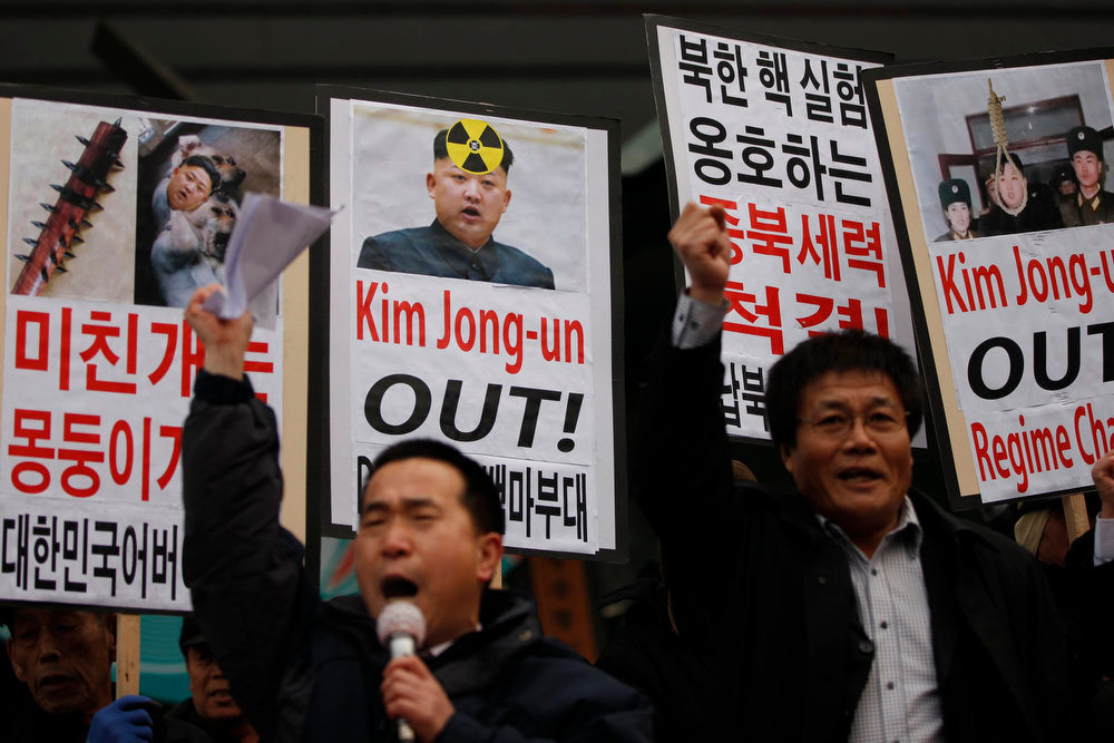 Description of . Activists from anti-North Korea civic group chant slogans during a rally against North Korea's nuclear test near the U.S. embassy in central Seoul February 12, 2013. North Korea conducted its third-ever nuclear test on Tuesday, a move likely to anger its main ally China and increase international action against Pyongyang and its new young leader, Kim Jong-un. U.N. Secretary-General Ban Ki-moon condemned North Korea's test, saying it was a