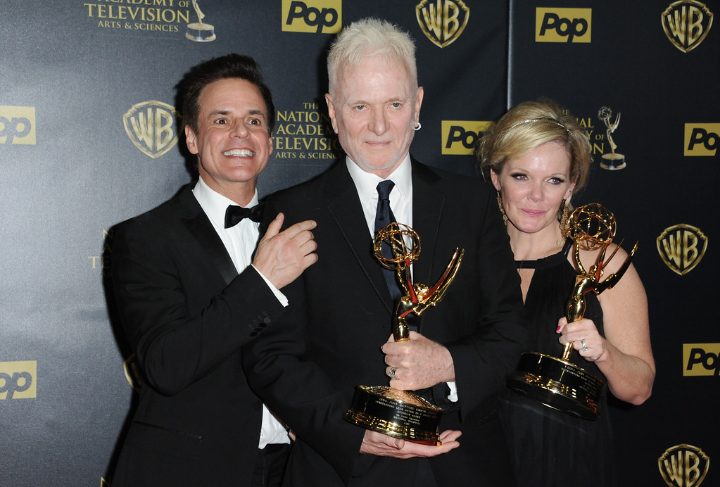 ". Christian Jules Le Blanc, left, poses with Anthony Geary and Maura West, right, winners of the awards for outstanding lead actor and actress in a drama series for ""General Hospital\"", at the 42nd annual Daytime Emmy Awards at Warner Bros. Studios on Sunday, April 26, 2015, in Burbank, Calif. (Photo by Richard Shotwell/Invision/AP)"