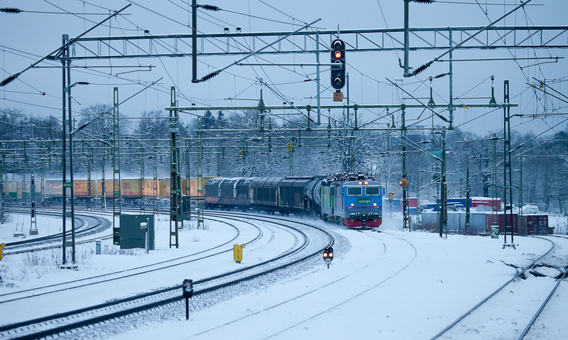 Freight train departing Västberga and passing through Älvsjö.