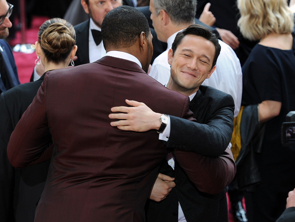 . Michael Strahan hugs Joseph Gordon-Levitt at  the 86th Academy Awards at the Dolby Theatre in Hollywood, California on Sunday March 2, 2014 (Photo by John McCoy / Los Angeles Daily News)