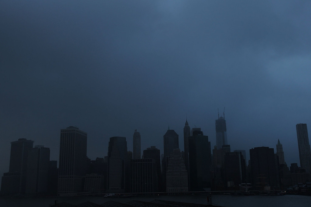 . A darkened Manhattan is viewed after much of the city lost electricity due to the affects of Hurricane Sandy on October 30, 2012 in New York, United States. At least 33 people were reported killed in the United States by Sandy as millions of people in the eastern United States have awoken to widespread power outages, flooded homes and downed trees. New York City was his especially hard with wide spread power outages and significant flooding in parts of the city. (Photo by Spencer Platt/Getty Images)