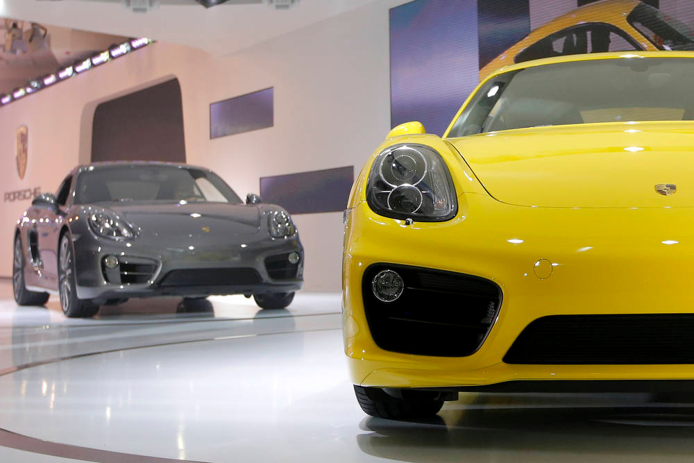 Description of . The new Porsche Caymans are introduced at the LA Auto Show in Los Angeles, Wednesday, Nov. 28, 2012. (AP Photo/Jae C. Hong)