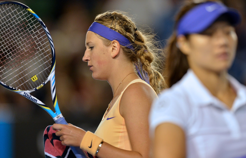 . Belarus\'s Victoria Azarenka (L) changes ends during her women\'s singles final against China\'s Li Na (R) on day thirteen of the Australian Open tennis tournament in Melbourne on January 26, 2013. PAUL CROCK/AFP/Getty Images