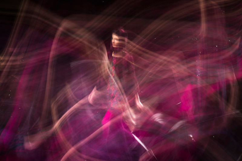. In this photo made with a long exposure, a model walks the runway at the Anna Sui Fall 2013 fashion show during Fashion Week, Wednesday, Feb. 13, 2013, in New York. (AP Photo/John Minchillo)