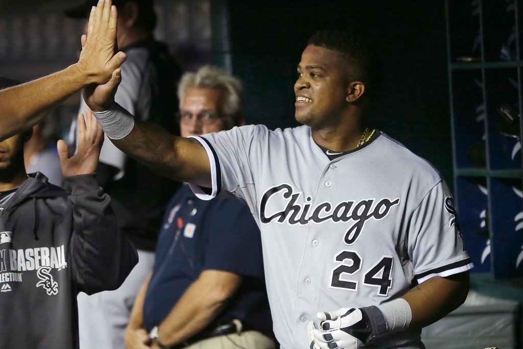 . Chicago White Sox\'s Dayan Viciedo is congratulated in the dugout after his sacrifice hit to score teammate Alexei Ramirez during the seventh inning of a baseball game against the Detroit Tigers, Wednesday, July 30, 2014 in Detroit. (AP Photo/Carlos Osorio)