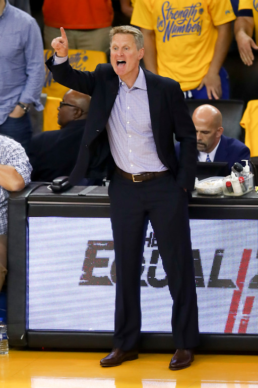 . Golden State Warriors head coach Steve Kerr gestures during the first half of Game 1 of basketball\'s NBA Finals between the Warriors and the Cleveland Cavaliers in Oakland, Calif., Thursday, May 31, 2018. (AP Photo/Ben Margot)