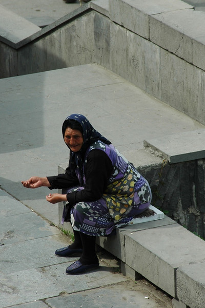 Woman Begging at the Church Steps - Tbilisi, Georgia