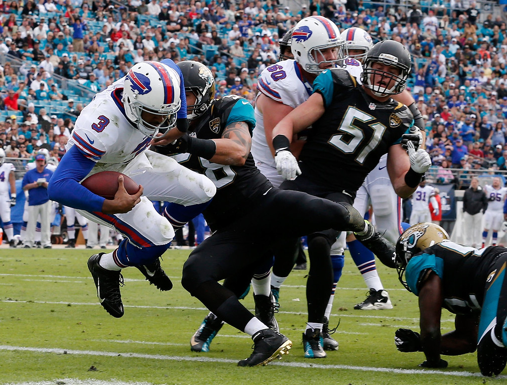 . EJ Manuel #3 of the Buffalo Bills crosses the goal line for a touchdown during the game against the Jacksonville Jaguars at EverBank Field on December 15, 2013 in Jacksonville, Florida.  (Photo by Sam Greenwood/Getty Images)