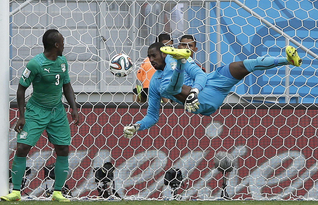 . Ivory Coast\'s goalkeeper Boubacar Barry (C) concedes a second goal during the Group C football match between Colombia and Ivory Coast at the Mane Garrincha National Stadium in Brasilia during the 2014 FIFA World Cup on June 19, 2014.  AFP PHOTO / ADRIAN DENNIS/AFP/Getty Images