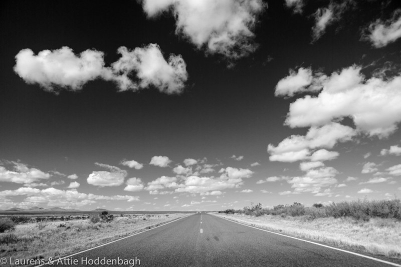 Road and clouds in the sky
