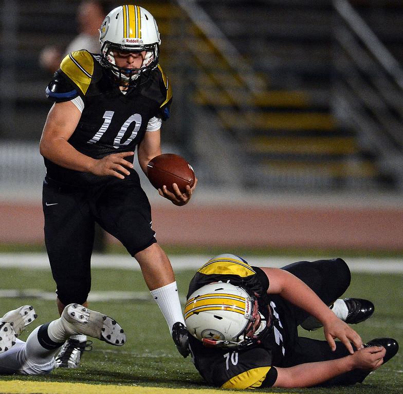 . Bassett quarterback Nicolas Colmenero (10) runs for a first down against Duarte in the first half of a prep football game at Bassett High School in La Puente, Calif., on Friday, Nov. 1, 2013.    (Keith Birmingham Pasadena Star-News)