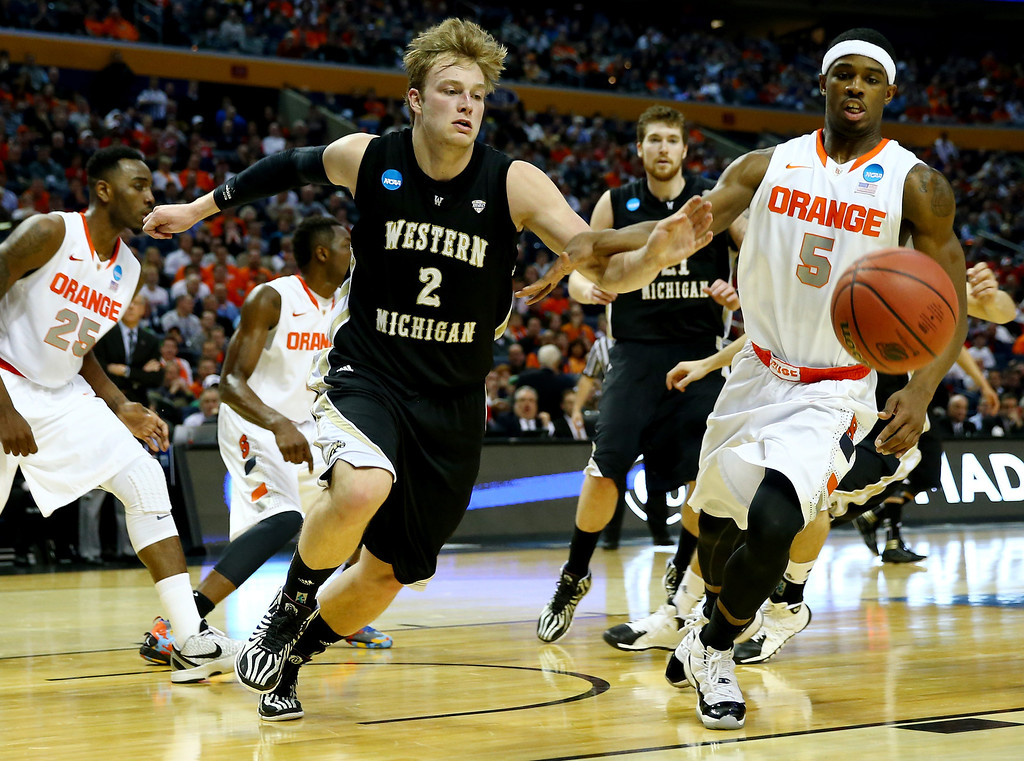 . BUFFALO, NY - MARCH 20: Connar Tava #2 of the Western Michigan Broncos and C.J. Fair #5 of the Syracuse Orange go for a loose ball during the second round of the 2014 NCAA Men\'s Basketball Tournament at the First Niagara Center on March 20, 2014 in Buffalo, New York.  (Photo by Elsa/Getty Images)