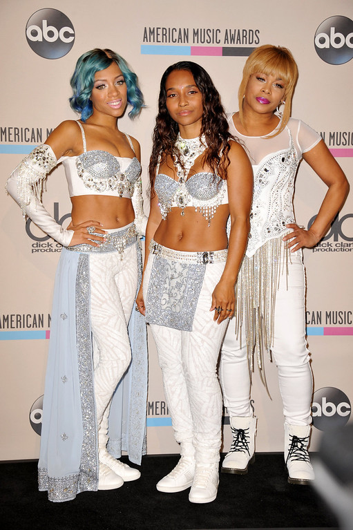 . From right, T-Boz and Chilli of the musical group TLC pose with Lil Mama backstage at the American Music Awards at the Nokia Theatre L.A. Live on Sunday, Nov. 24, 2013, in Los Angeles. (Photo by Jordan Strauss/Invision/AP)