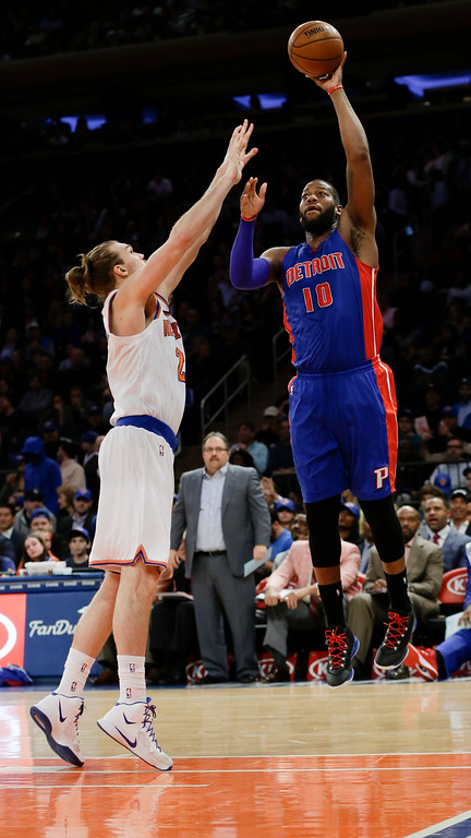 . Detroit Pistons\' Greg Monroe (10) shoots over New York Knicks\' Lou Amundson (21) during the first half of an NBA basketball game Wednesday, April 15, 2015, in New York. (AP Photo/Frank Franklin II)
