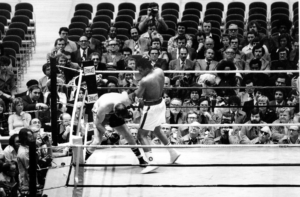 . World heavyweight champion Muhammad Ali has challenger Chuck Wepner in the corner during first round of their title bout in the Cleveland Coliseum in Richfield, Ohio, Monday night, March 24, 1975.  (AP Photo)