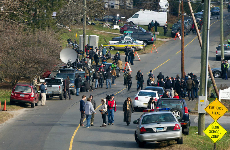 . Media and residents gather near the entrance to the Sandy Hook Elementary School on December 15, 2012 in Newtown, Connecticut. The residents of an idyllic Connecticut town were reeling in horror from the massacre of 20 small children and six adults in one of the worst school shootings in US history. The heavily armed gunman shot dead 18 children inside Sandy Hook Elementary School, said Connecticut State Police spokesman Lieutenant Paul Vance. Two more died of their wounds in hospital.     DON EMMERT/AFP/Getty Images
