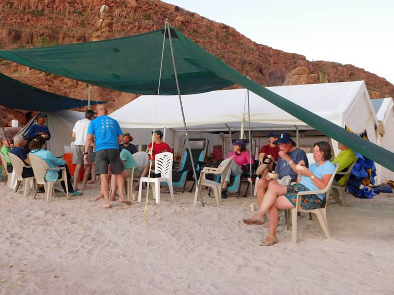 group of people sitting around a glamping area