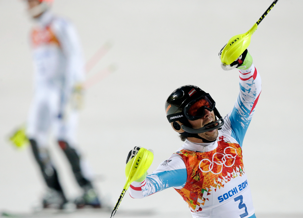 . Austria\'s Mario Matt celebrates winning the gold medal in the men\'s slalom at the Sochi 2014 Winter Olympics, Saturday, Feb. 22, 2014, in Krasnaya Polyana, Russia. (AP Photo/Gero Breloer)