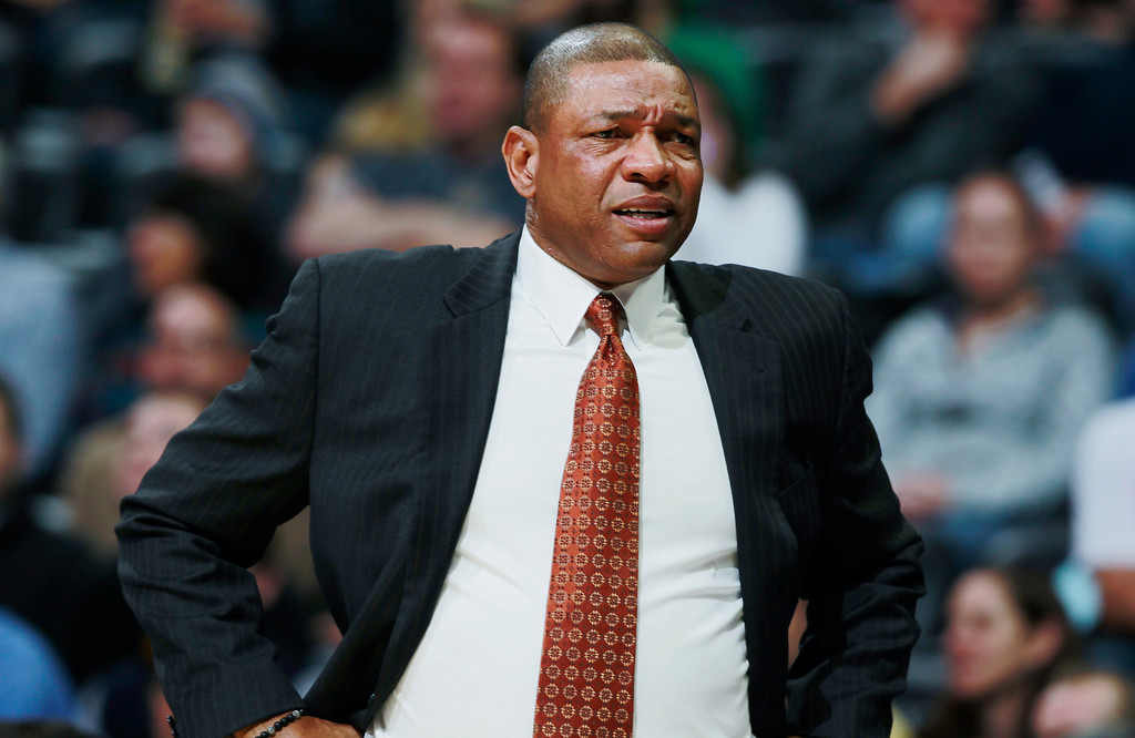 . Los Angeles Clippers head coach Doc Rivers reacts to call against his team in the first quarter of an NBA basketball game against the Denver Nuggets in Denver, Monday, Feb. 3, 2014. (AP Photo/David Zalubowski)