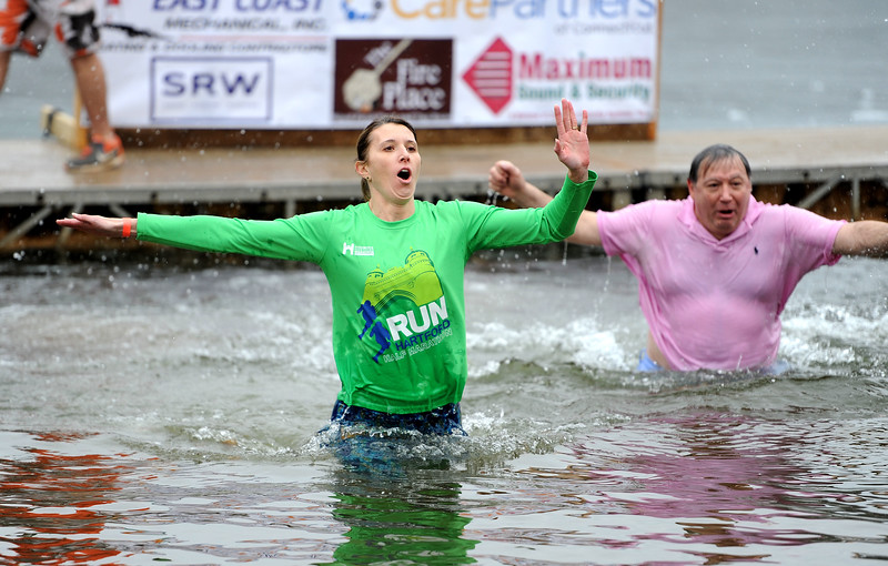 1/19/2019 Mike Orazzi | Staff Kelly Morrissey and Al Natelli  during the 14th annual Sloper Plunge at Camp Sloper's pond Saturday in Southington.