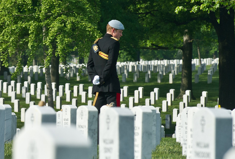 . Prince Harry of Great Britain, wearing his British Army ceremonial uniform of the Blues And Royals in his role as Captain Harry Wales, visits Section 60 of Arlington National Cemetery, where veterans of the wars in Iraq and Afghanistan are buried, on May 10, 2013 in Arlington Virginia. During his visit to the US, Prince Harry will be undertaking engagements on behalf of charities with which he is closely associated, on behalf also of HM Government, with a central theme of supporting injured service personnel from the UK and US forces.  (Photo by Nicholas Kamm - Pool/Getty Images)