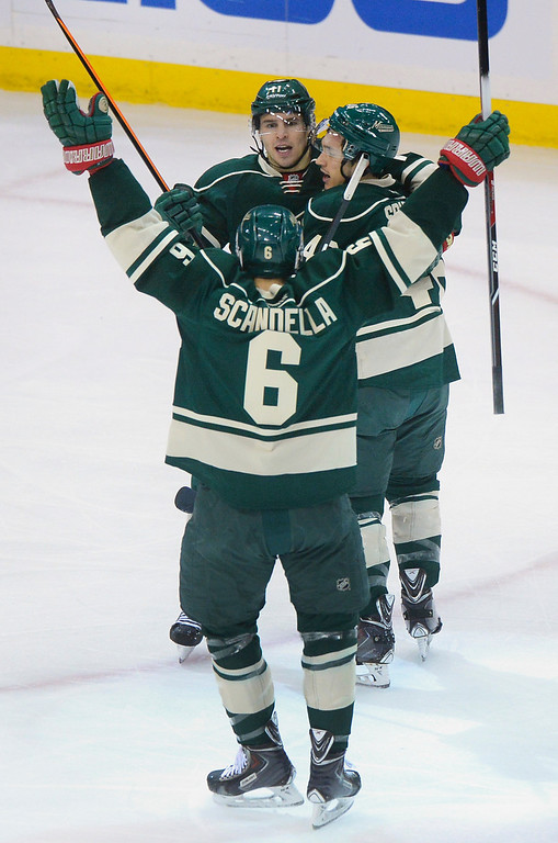 . Wild defenseman Jared Spurgeon, center, celebrated his first period goal with teammates Thursday night.  (Photo by Karl Gehring/The Denver Post)