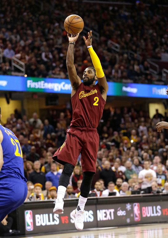 . Cleveland Cavaliers\' Kyrie Irving shoots against the Golden State Warriors in the first half of an NBA basketball game, Sunday, Dec. 25, 2016, in Cleveland. (AP Photo/Tony Dejak)