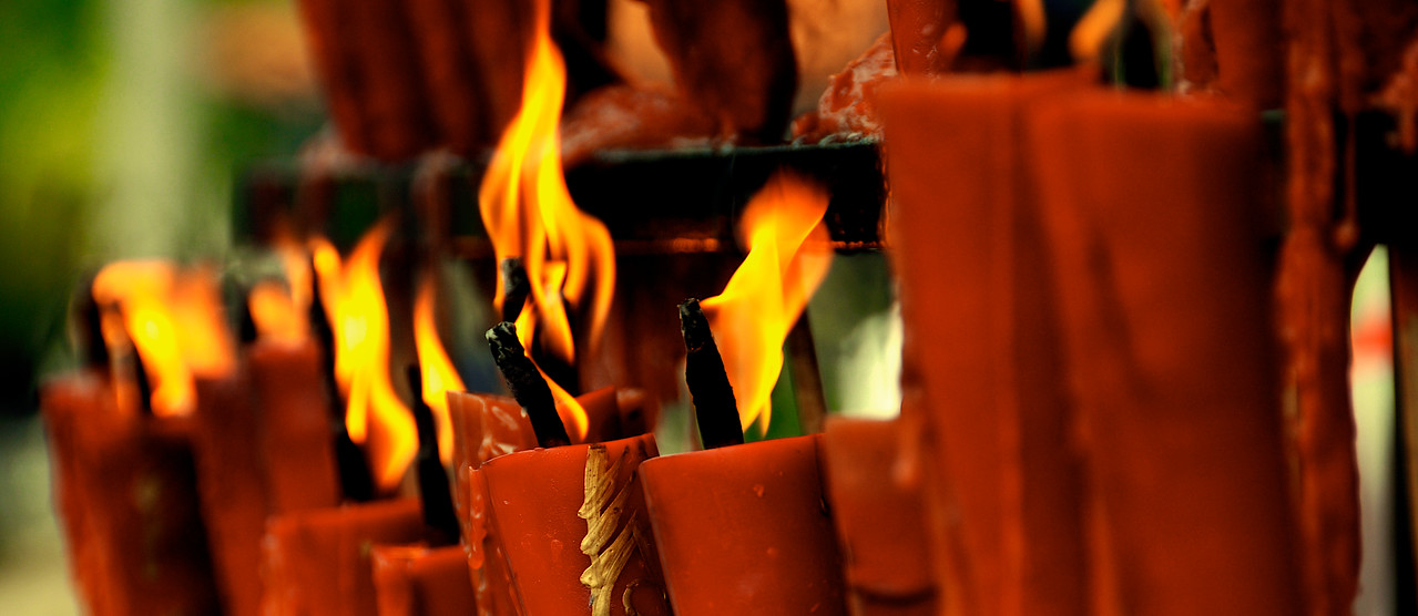 Candles outside Buddhist Temple, Hainan Island, China