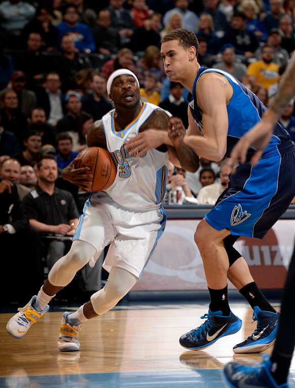 . DENVER, CO - JANUARY 14: Denver Nuggets guard Ty Lawson (3) drives and gets fouled by Dallas Mavericks forward Dwight Powell (8) during the first quarter January 14, 2015 at Pepsi Center. (Photo By John Leyba/The Denver Post)